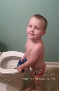 "Jake ""helping"" to wash his shirt in the toilet."